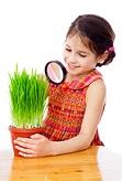 girl looking at grass