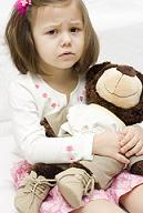sad girl with teddy bea